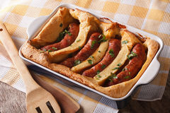 English food: toad in the hole into a baking dish close up. Horizontal stock photography