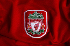 Liverpool emblem. English football club Liverpool emblem on football shirt stock photos