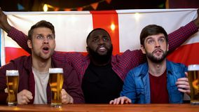 English football team losing game, multiracial male football fans disappointed. Stock photo stock photos
