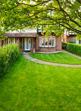 English front garden. Front lawn of a brick house in England Stock Photo