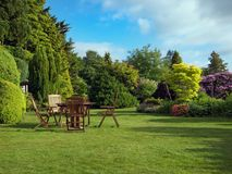 English Garden. In summer with furniture royalty free stock photo