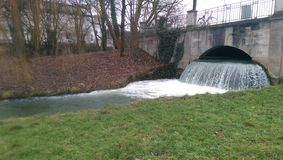 English garden, Munich. Water falling. Winter Royalty Free Stock Photos