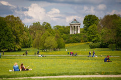 English Garden. Photo of the English Garden in Munich, Bavaria on a sunny weekend. People enjoying sunshine and the beautiful nature stock photography