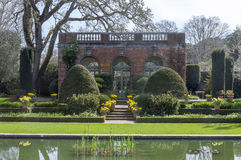 English Garden. And pond. Tea room in the background stock photography