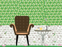 English garden style, Sofa with a cup of tea on table with brick wall and green leaf pattern background Stock Images