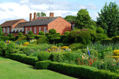 English garden in summer. English garden and two old houses in summer stock photography