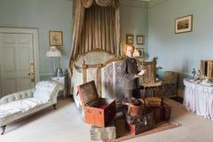 English gentleman with suitcases. Wax figure of English gentleman preparing to journey. Warwick Castle bedroom scene. Warwickshire, England Royalty Free Stock Photos