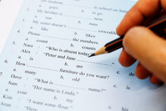 English grammar test. Blue english grammar test on table royalty free stock photo