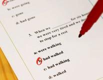 English grammar test sheet. On wooden desk Stock Photo