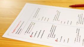 English grammar test sheet. On wooden desk Royalty Free Stock Photos