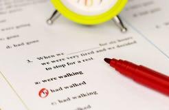 English grammar test sheet. On wooden desk Royalty Free Stock Image