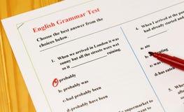 English grammar test sheet. On wooden desk Stock Photography