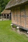 English Granary with staddlestones. Royalty Free Stock Photo