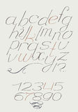 English hand drawn italic type script from a to z with digits from 0 to 9. Calligraphy made with nib beautiful elegant alphabet, p Stock Image