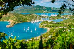 English harbour and Nelsons Dockyard in Antigua. And Barbuda, paradise island of antigua in the caribbean at the viewpoint of Shirley Heights and Freeman`s bay stock image
