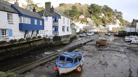 English harbour Polperro Cornwall South West England UK out of season in winter with boats at low tide stock footage