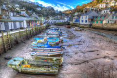 English harbour Polperro Cornwall South West England UK out of season in winter with boats at low tide Stock Photos