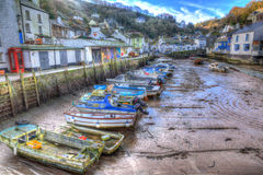 English harbour Polperro Cornwall South West England UK out of season in winter with boats at low tide HDR Royalty Free Stock Photography