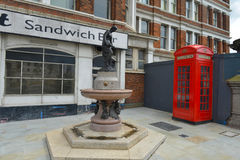 English historic corner with telephone box. Image was taken on July 2012 Royalty Free Stock Images