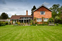 English house. Old english house on field stock image