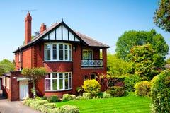 Typical English house in spring garden Royalty Free Stock Photos