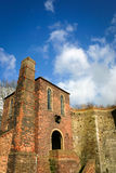 English industrial building. An old English Victorian blast furnace in Coalbrookdale, Shropshire, with an entrance and windows that resemble a human face Royalty Free Stock Images