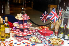 English Jubilee Tea Party. A very english or british tea party set up in a shop window display in london to celebrate the diamond jubilee in britain for Queen Royalty Free Stock Photography