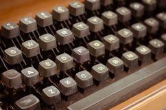English Keyboards of Old Typewriter In Vintage Tone. The old English typewriter is old object in warm vintage tone Royalty Free Stock Image