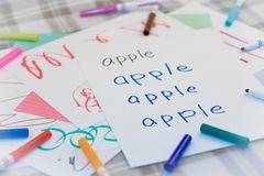 English; Kids Writing Name of the Fruits for Practice.  royalty free stock image