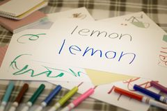 English; Kids Writing Name of the Fruits for Practice.  stock images