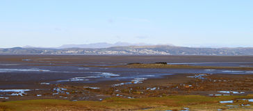English Lake District panorama from Hest Bank. View from Hest Bank looking across Morecambe Bay to Grange over Sands and the English Lake District hills beyond Royalty Free Stock Image