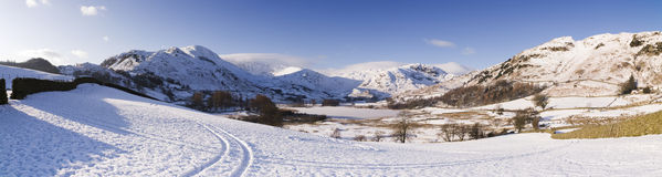 English Lake District in winter. A heavy fall of snow lies on top of the mountains surrounding the Little Langdale Valley in the English Lake District. Little Stock Photography