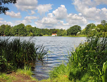 English Lake With House In The Distance Stock Photos
