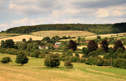English Landscape. Summer Sunshine over an English Rural Landscape showing a small Hamlet surrounded by fields and woods with a railway line passing through Royalty Free Stock Photos