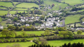 English Landscape. Combe Martin in Devon. The green fields with the Devon village of Combe Martin nestling in the valley below. Photograph taken in May 2016 royalty free stock images