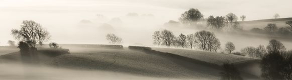 English Landscape in the Morning Mist stock photography