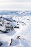 English landscape in winter. Snow covered tor landscape in winter, Kinder Scout, Derbyshire, England, UK Stock Photos