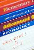 English language books. English language learning books with the proficiency focused, a teacher's note well done in a notebook Stock Photo