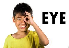 English language learning card with portrait of 8 years old child pointing his eye isolated on white background as part of school stock photos