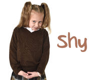 English language learning vocabulary school card with word sad and young sweet little schoolgirl. English language learning vocabulary school card with word shy Stock Image