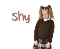 English language learning vocabulary school card with word sad and young sweet little schoolgirl Stock Photos