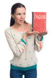 English language learning. Woman holding an English textbook. Over white background Royalty Free Stock Photo
