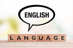 English language lesson sign on a table. English language lesson sign made of cubes on a table royalty free stock photos