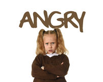 English learning vocabulary card with the word angry and portrait of sweet beautiful little child girl upset. English language learning vocabulary school card Royalty Free Stock Photography