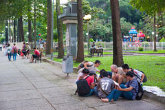 English lesson in Saigons park Royalty Free Stock Images