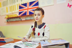 An english lesson. School girl in the class of english Royalty Free Stock Photos