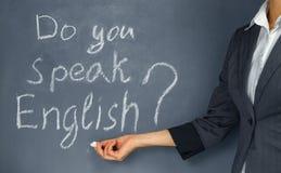 English lesson. Unrecognizable teacher points to the phrase: Do you speak English Royalty Free Stock Photos