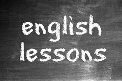 English lessons. Written in chalk on an old blackboard Stock Images