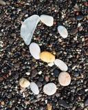 Letters alphabet laid on a black sand. S. English letters of alphabet laid on a black sand. S stock images