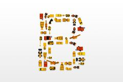 English letters formed by arrangement of Car toy diecast on the. White background , Top view stock photos